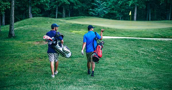 golfers walking along course
