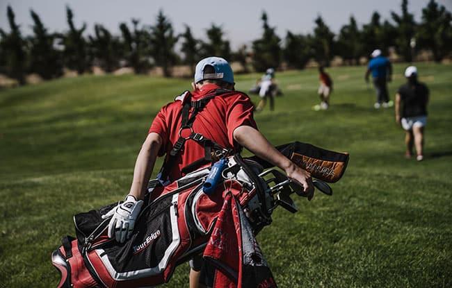 golf caddie carrying bag