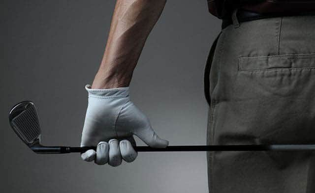 man holding a 6 iron golf club