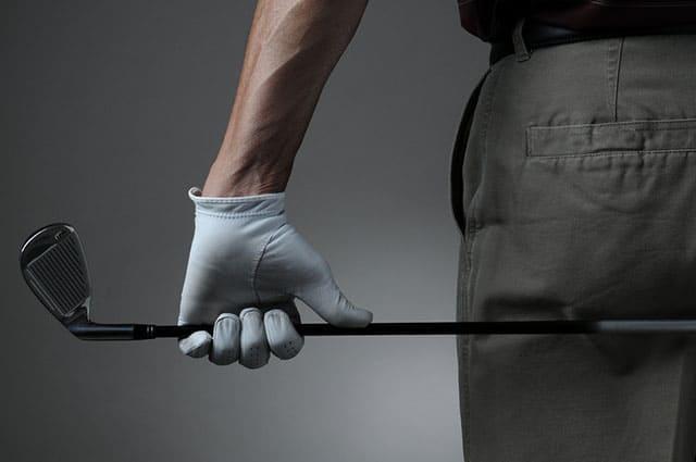 golfer holding a 7 iron golf club