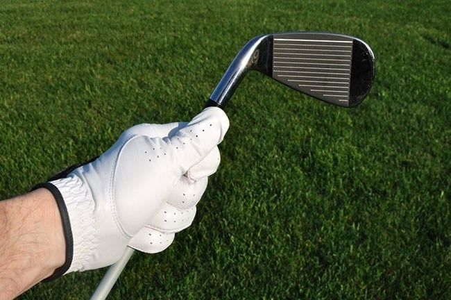 holding a golf iron shaft that's too light