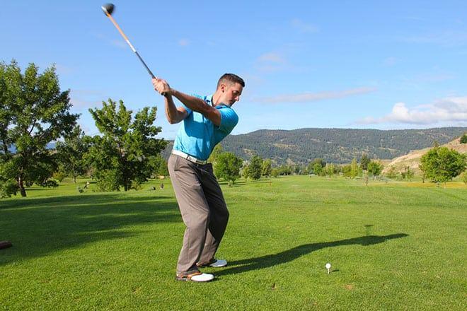 Golfer Practises Hybrid Swing