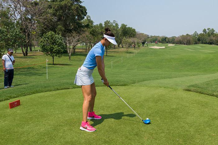 Golfer using a fitted golf club