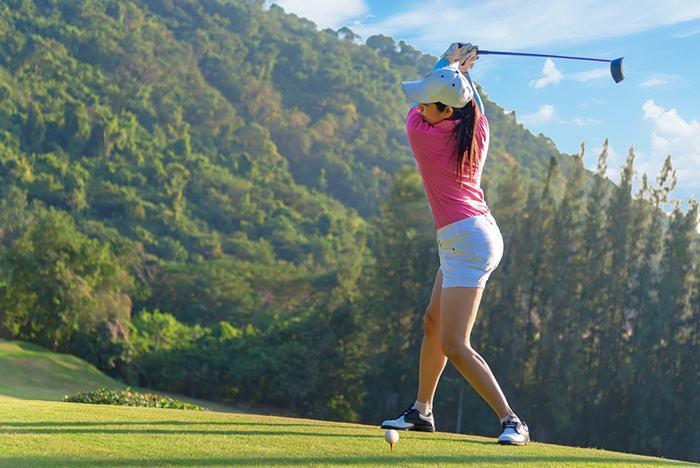 Golfer using 9 degree driver