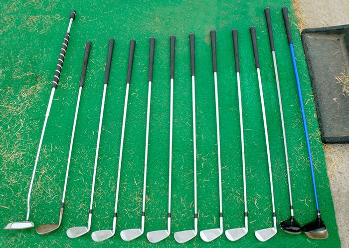 golf clubs stored vertically