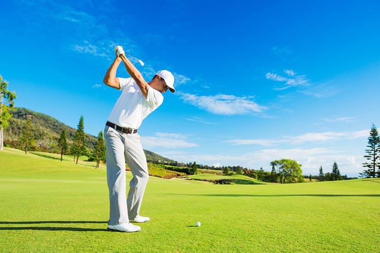golfer hitting 200 yard golf drive